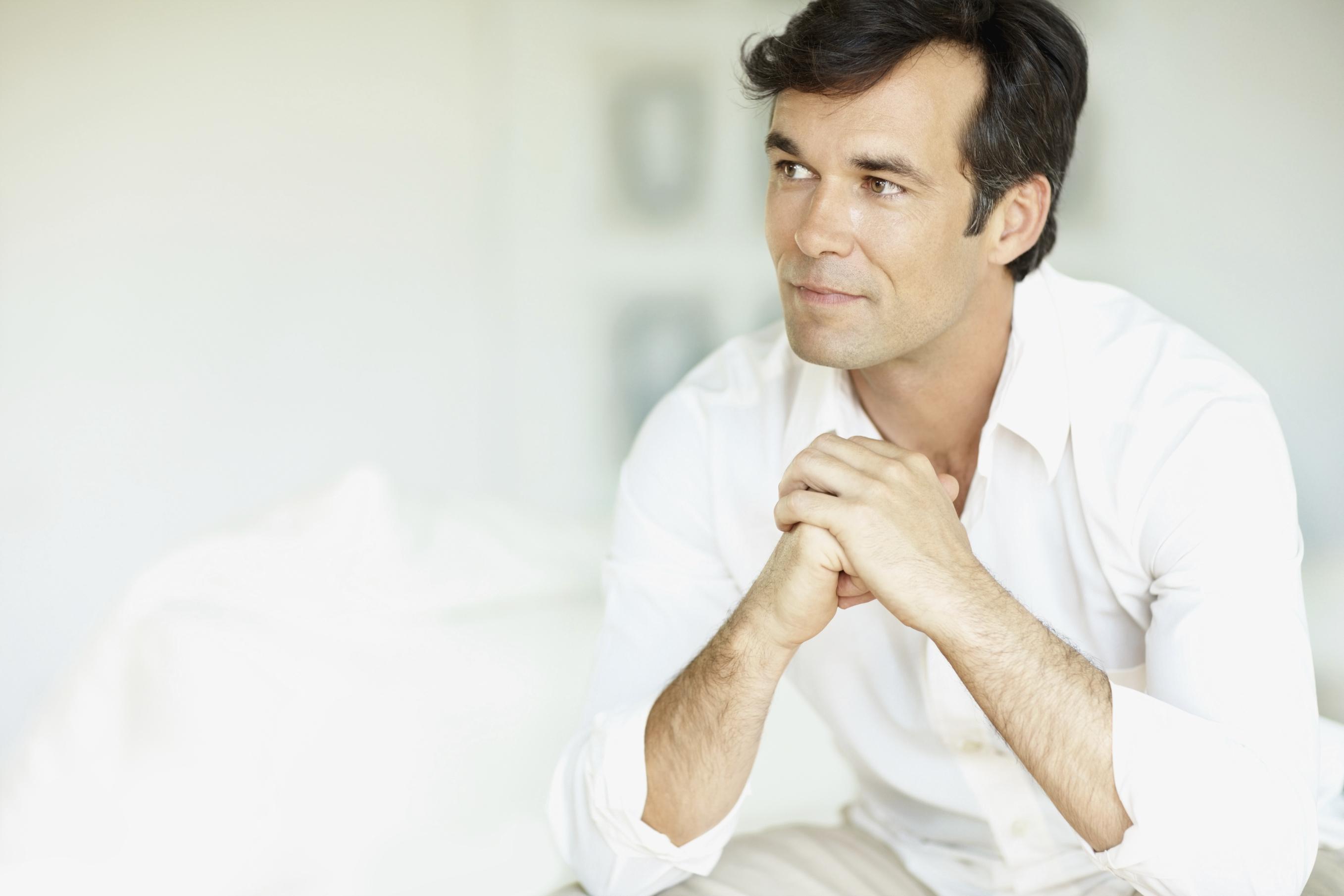 Close-up of of a contemplative mature man looking away