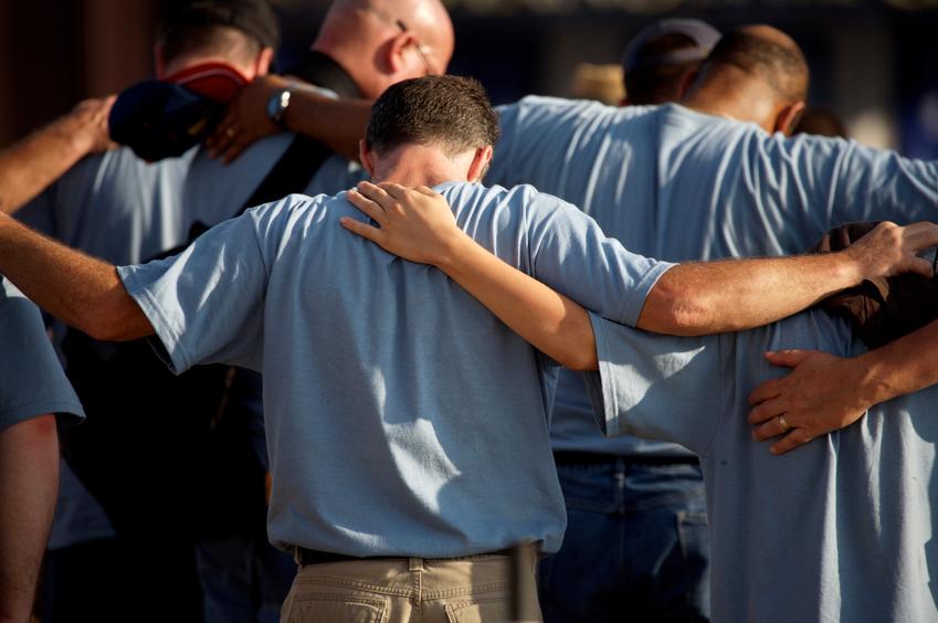 US Capitol City photo scenes men gathered in prayer